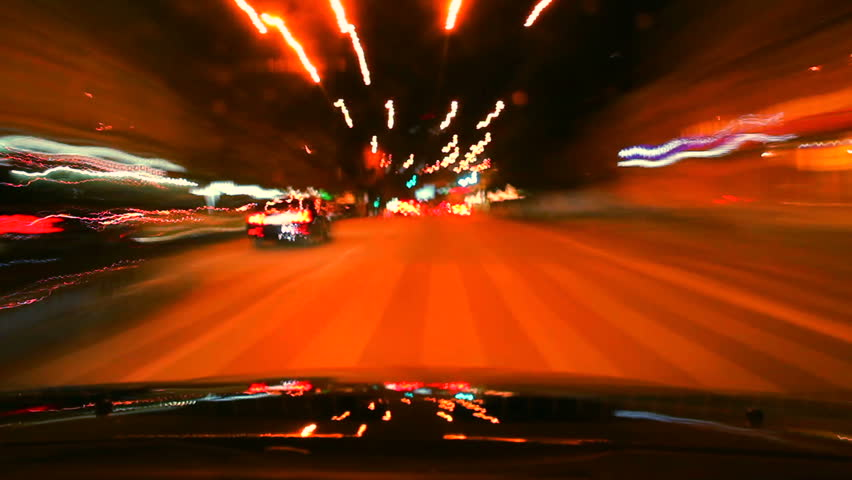 Night car drive around time lapse. Cars leave trace with lights