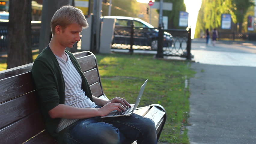 Man laptop turns seriously looks, success, victory, development