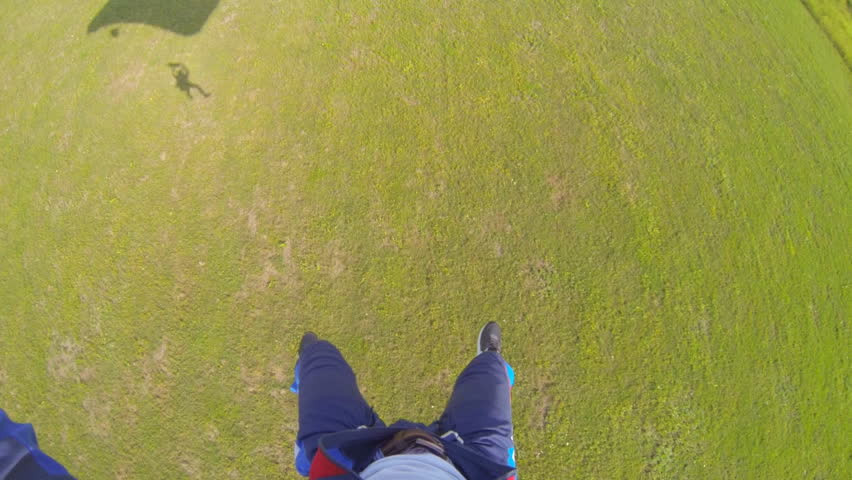 Video parachute jumps (skydiving) from a first-person skydiver landing | Shutterstock HD Video #4576775