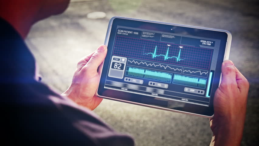 A doctor looks at a futuristic mobile health device. | Shutterstock HD Video #4577096