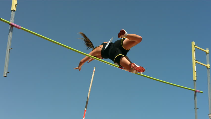 Track and Field athlete doing pole vault, slow motion