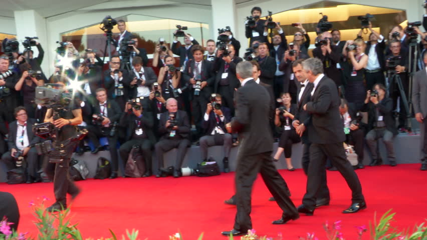 VENICE - AUGUST 28: George Clooney, Sandra Bullock and Alfonso Cuarón on the red carpet for the movie