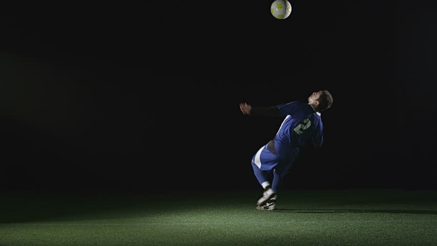 A very good soccer player catches a ball with his chest and then jumps in the air and kicks the ball. Wide slow motion shot. | Shutterstock Video #4650632