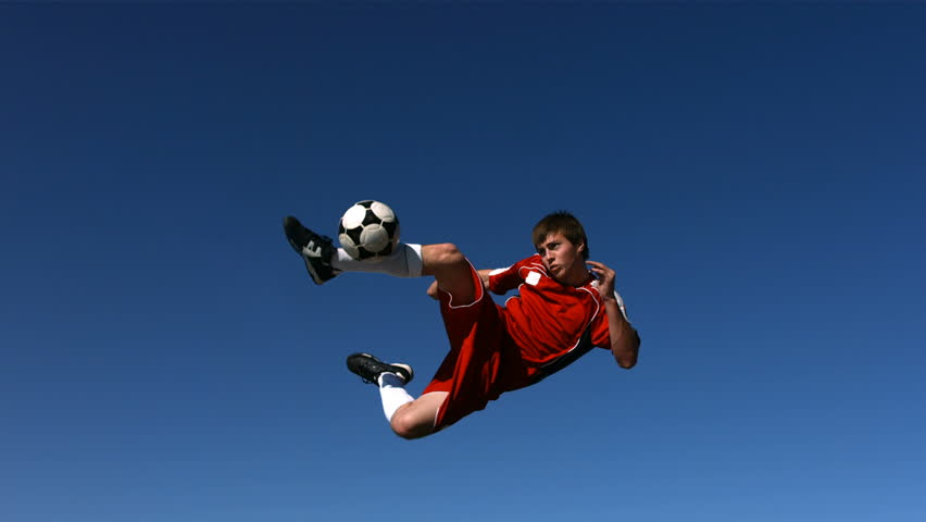 Soccer player kicking ball in mid-air, slow motion | Shutterstock Video #4656179