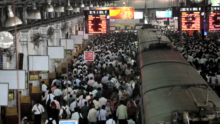 India - January 2011: People filling a railroad station platform as they disembark into a crowded train station at Victoria Terminus, Mumbai, India in January, 2011
