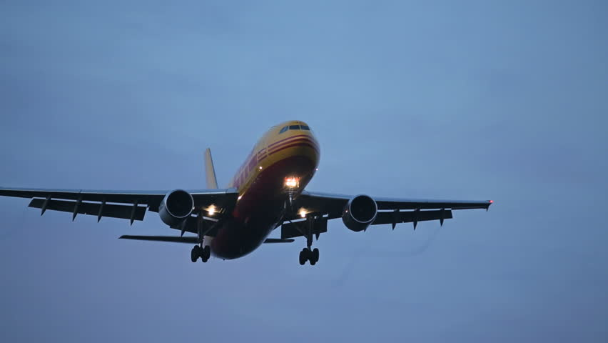 OSLO AIRPORT 14 SEPT 2013: DHL freight airplane flying overhead for landing at