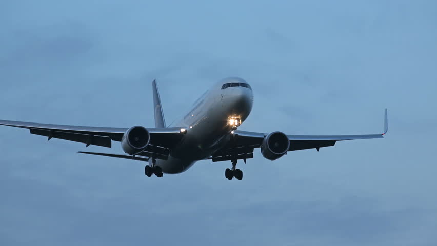 OSLO AIRPORT 14 SEPT 2013: Freight airplane flying overhead for landing at Oslo