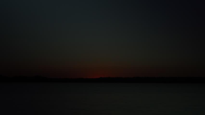 Timelapse of a Fiery sunrise over a Colorado Lake. HD 1080p