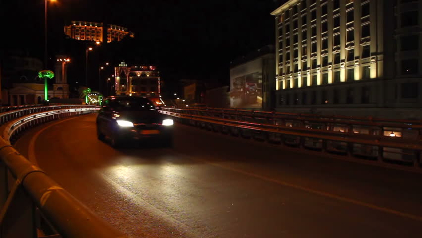 Cars drive by road junction bridge part urban city night
