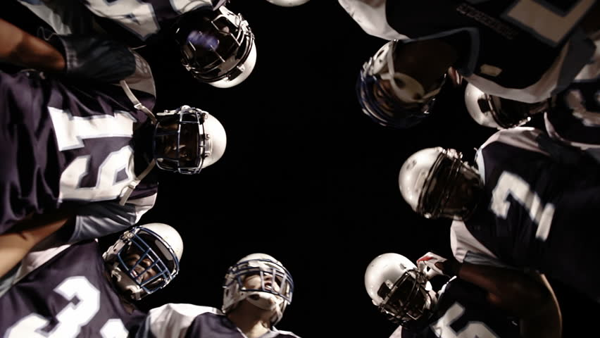 Low angle view looking up into the inside of a huddle | Shutterstock Video #4706138