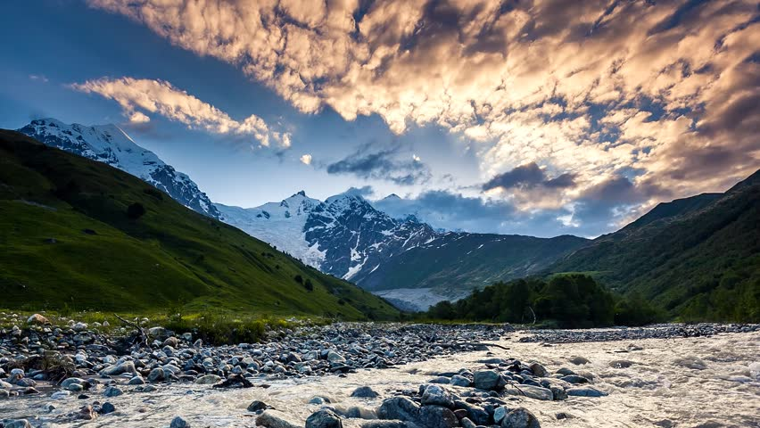 Time lapse clip. River in mountain valley at the foot of Tetnuldi glacier. Upper