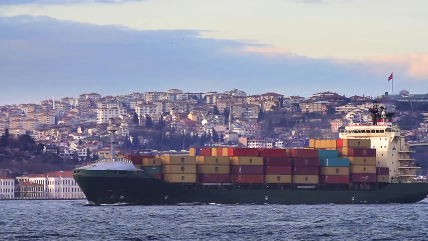 Container Transportation. Cargo ship full of containers sailing in Bosphorus