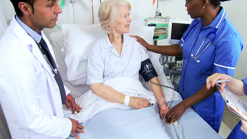 Close up of nursing staff monitoring blood pressure of an elderly female patient in a hospital ward   Shutterstock HD Video #4761440