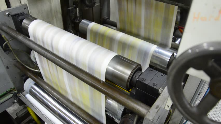 News print factory - Stock Video. Newspapers being carried to folding and