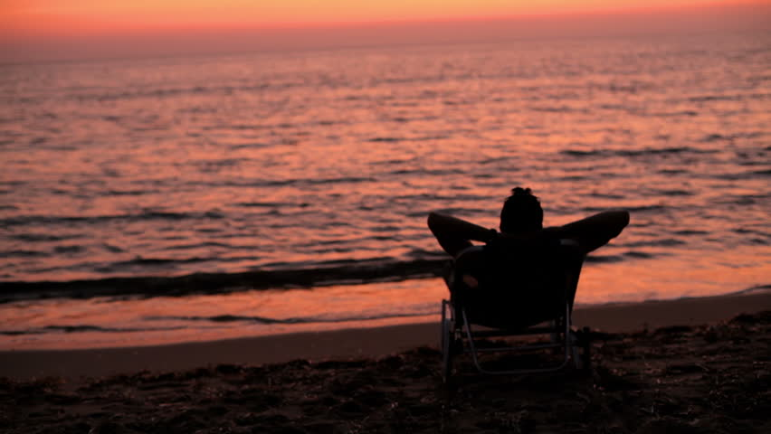 Man relaxing sunset
