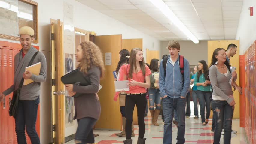 A Busy School Hallway With Students Walking To And From ...