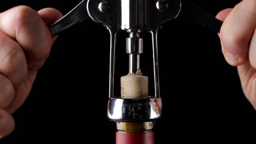 Corkscrew opening bottle of wine