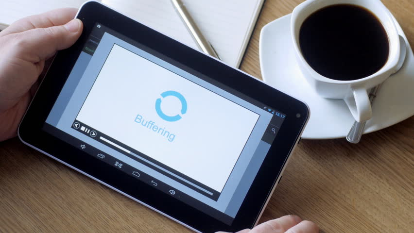 Man waiting for video buffering on tablet pc