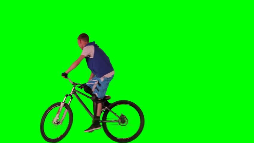 Boy on bike. Green screen footage.