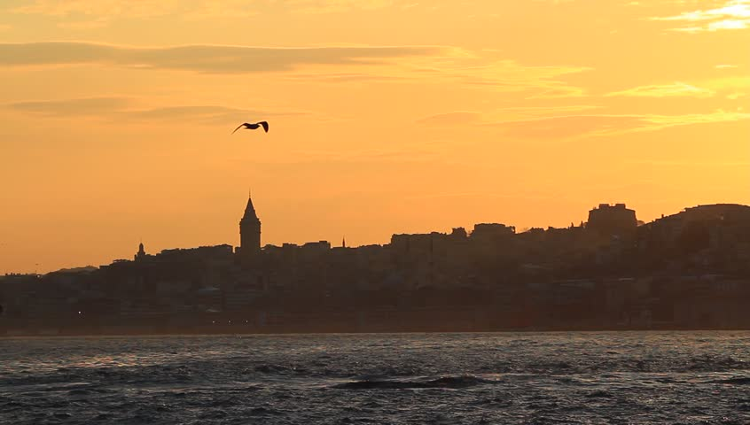 Sundown at Istanbul. In the distance are Galata Tower and the city silhouette.