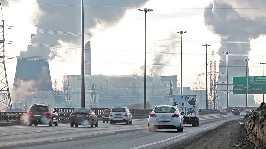 City ringway with air pollution from heat electric generation plant in Saint-Petersburg, Russia. Strong vapor and smoke due extreme cold