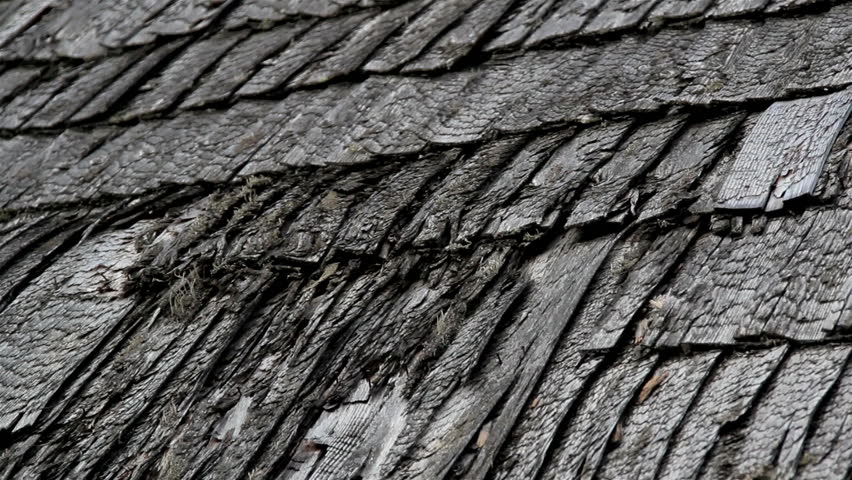 Old Broken Cedar Wooden Shake Shingle Roof Looks Really Tattered And Needs  To Be Replaced.