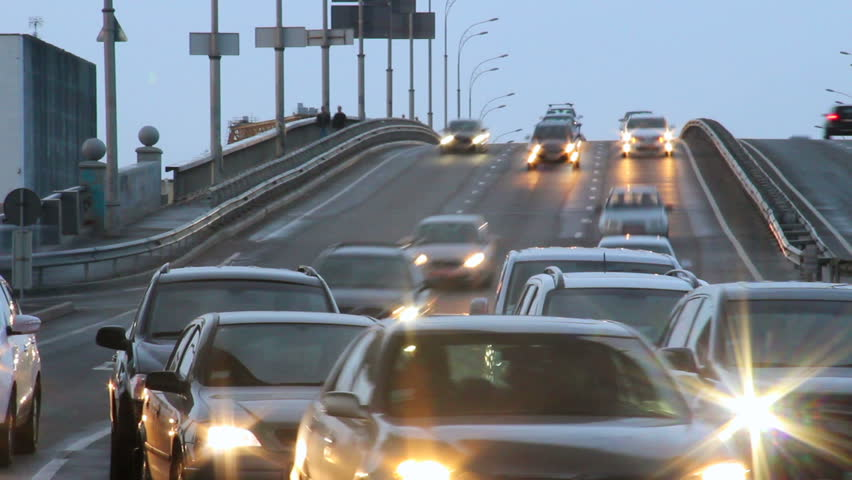 Thousand cars driving city dusk timelapse, traffic, lights on