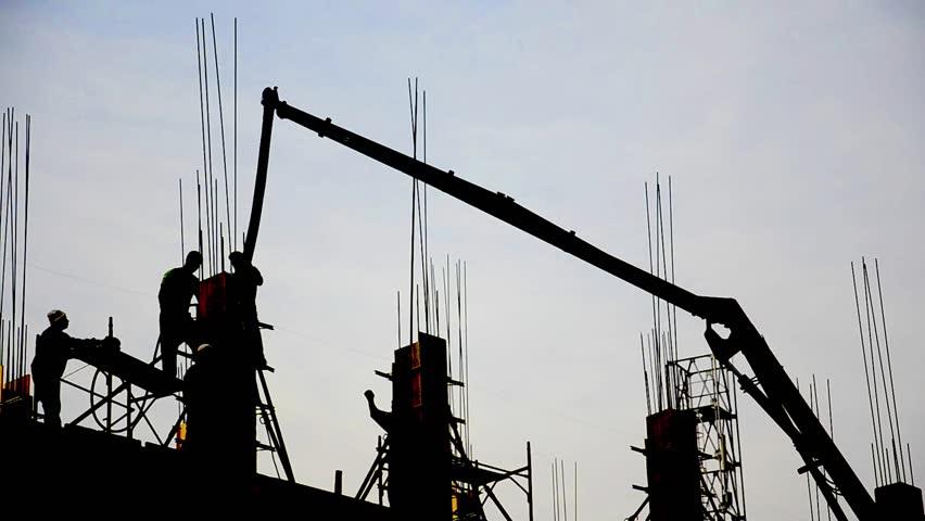 Building Under Construction. Post concrete filling at high skyscraper