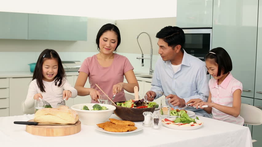 happy family using laptop together at home in the kitchen stock, Kitchen design