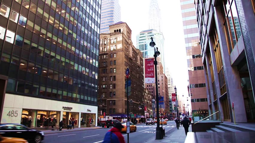 NEW YORK CITY - DEC 29: Famous Lexington Avenue with a view of the Chrysler building December 29th, 2009 in New York City.   Shutterstock HD Video #5186690
