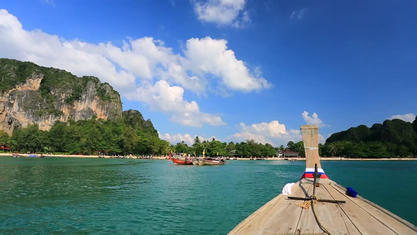 Moving to the Railay beach on thai traditional wooden boat. Krabi, Thailand.