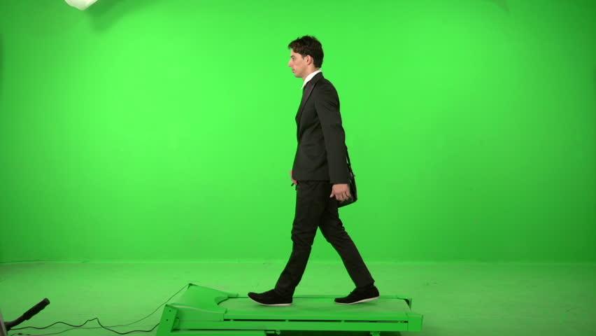 business man walking on a green screen backround