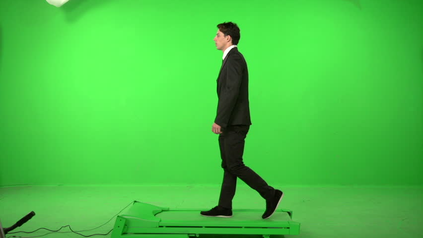 business man walking on a green screen backround