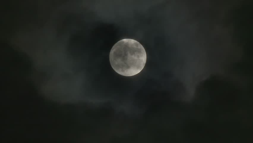 A realtime shot of the full moon on a cloudy night. Not computer generated. In