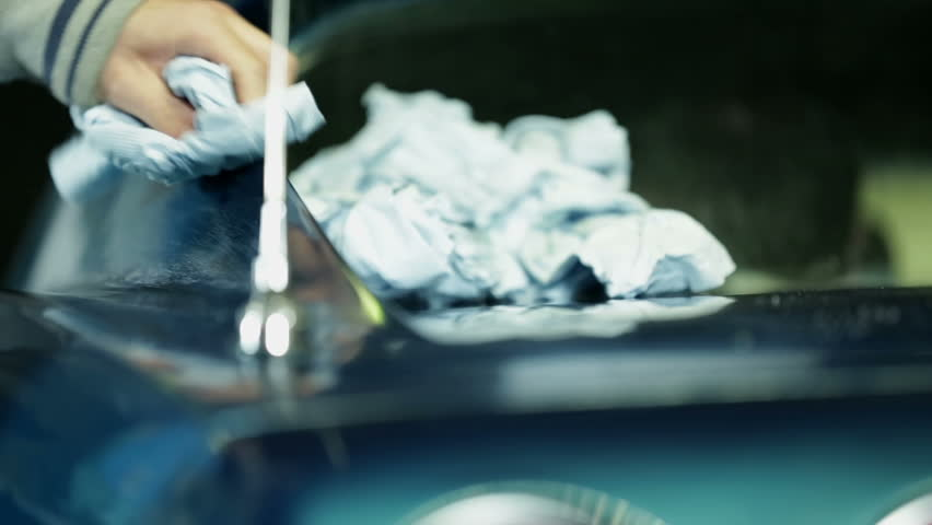 Polishing the blue car with white cloth   Shutterstock HD Video #5259773