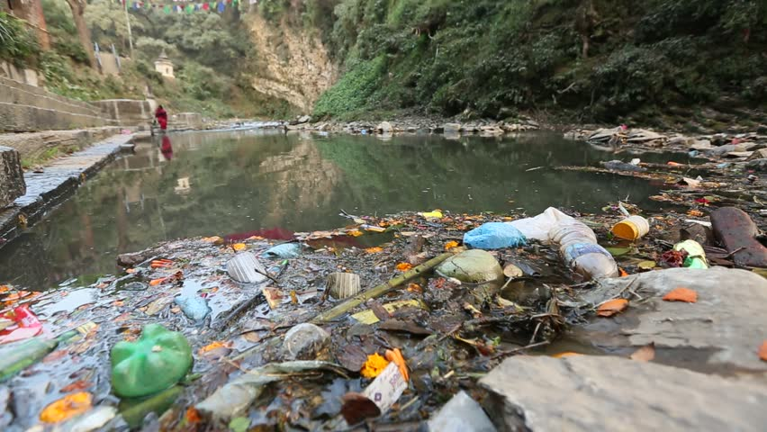 Environmental pollution in the Himalayas. Garbage in the water of river Bagmati.