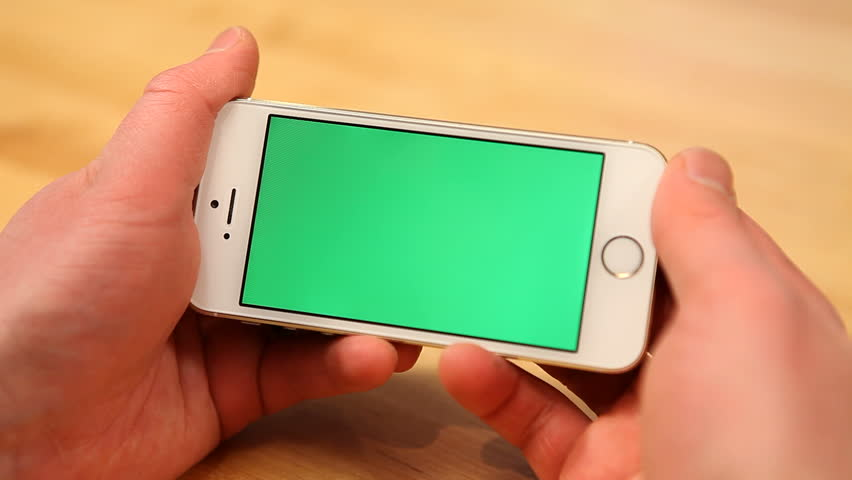 Using smart phone on wood table w/various hand gestures, horizontal, close up - green screen