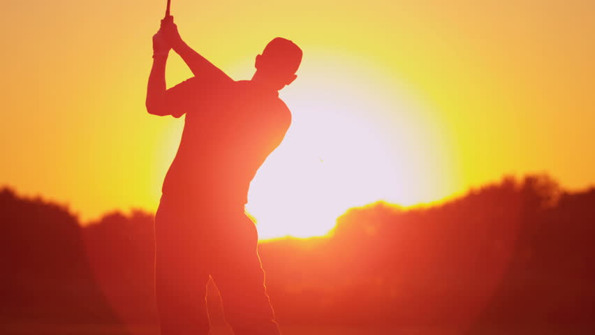 Close up silhouette weekend male golfer enjoying time golf course in summer driving off down fairway sunset shot on RED EPIC, 4K, UHD, Ultra HD resolution