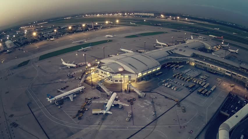 Timelapse.Aerial View.Airport Terminal at Sunset with Airplanes Taxiing and Landing. | Shutterstock HD Video #5392802