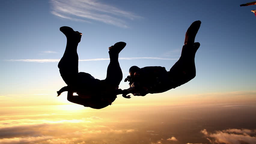 Skydiving formation at sunset   Shutterstock HD Video #5416694
