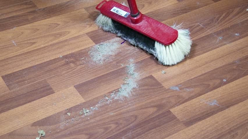 housekeeper cleaning wooden laminate floor using mop stock footage