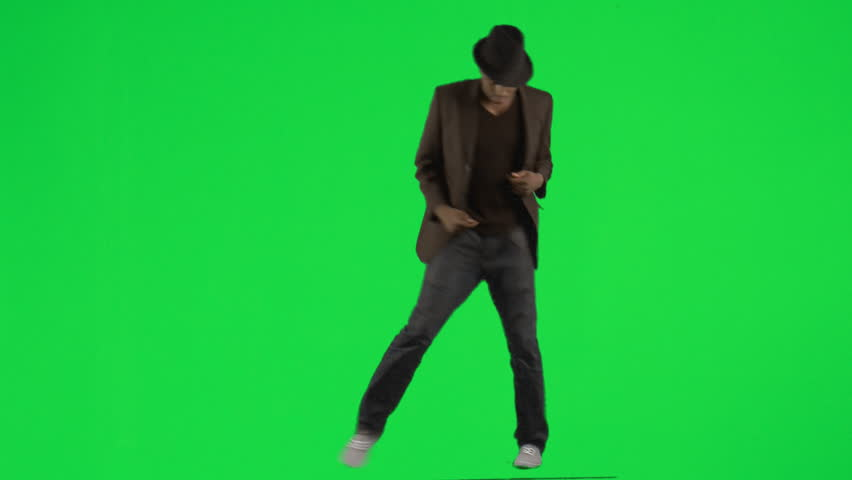 Ethnic young man dancing with a hat and a jacket footage