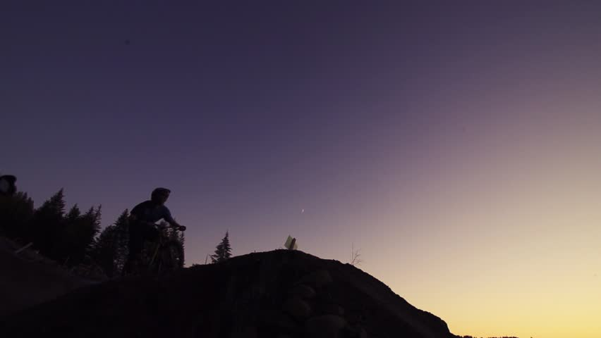 Two bikers jumping over the sunset, super slow motion. | Shutterstock HD Video #5538047