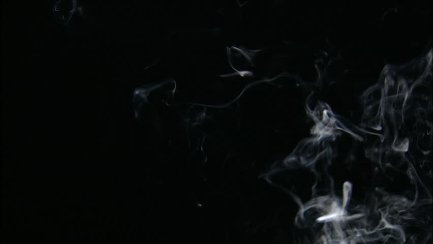 Trail of smoke on a black background.