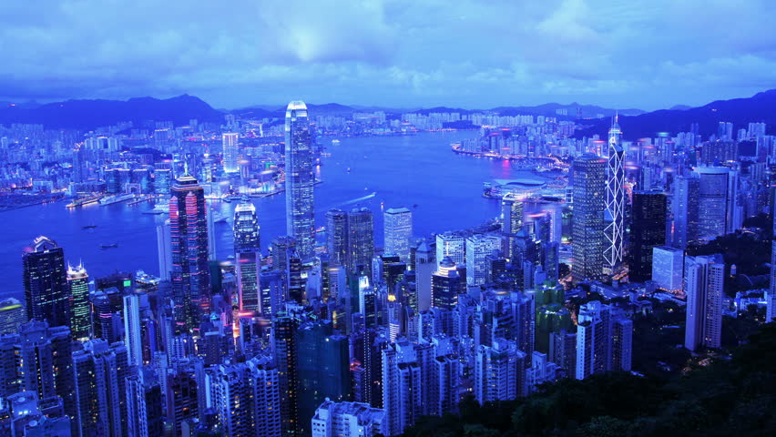 Hong Kong. 4K City Timelapse. Timelapse video of Hong Kong from day to night. Wide and high angle view from the Peak of Hong Kong. Office buildings and busy traffic under clear night sky. | Shutterstock HD Video #5615390