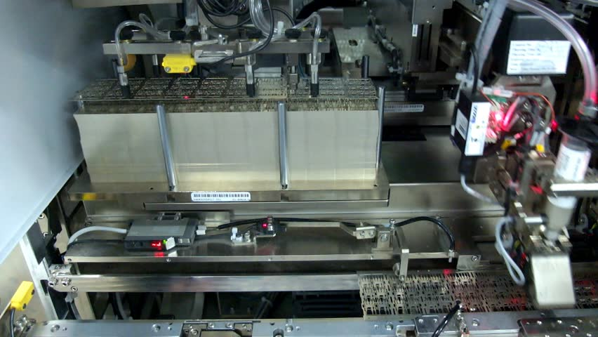 Automated machine picking leadframe module production,IC,factory | Shutterstock HD Video #5636174