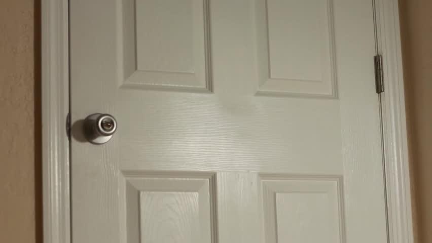 Doorknob turning and door opening by itself | Shutterstock HD Video #5642804