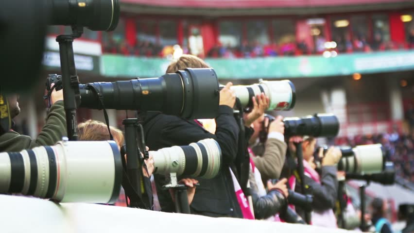 Lenses of many photographers working in sporting event #5694089