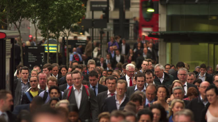 LONDON, UK - OCTOBER 10, 2011: Busy street filled with commuters.