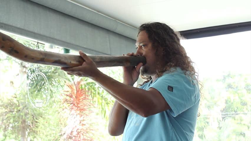 PORT DOUGLAS, AUSTRALIA - FEB 28: Linc Walker of the Kuku Yalanji tribe demonstrates the Didgeridoo on Feb 28, 2014 in Port Douglas, Australia.  The Kuku Yalanji people are native to North Queensland